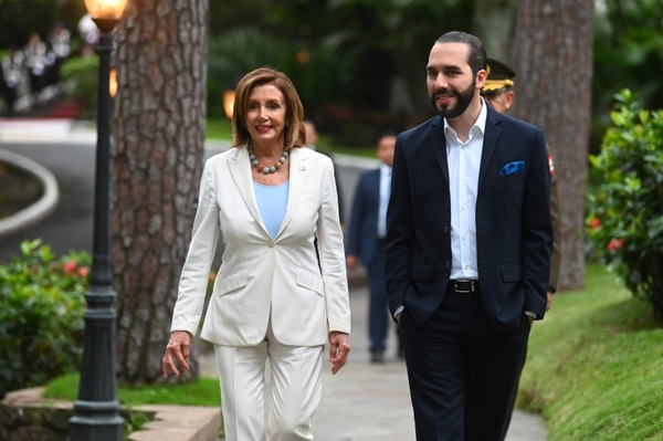 US Speaker of the House Nancy Pelosi (L) walks with Salvadorean President Nayib Bukele after a joint press conference at the presidential palace in San Salvador, on August 9, 2019. (Photo by Oscar Rivera / AFP)