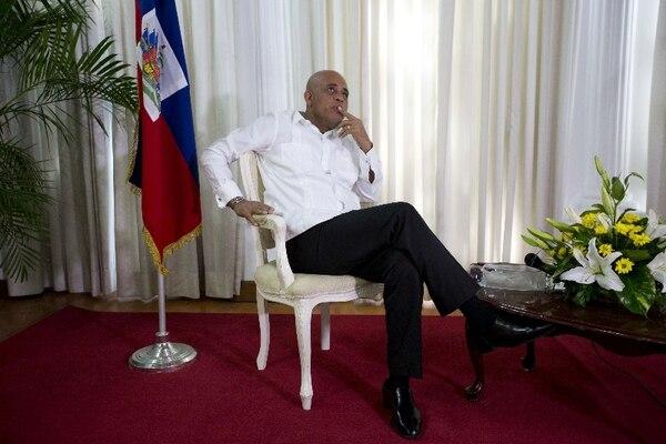 Michel Martelly, presidente de Haití, anunció que una comisión de cinco miembros evaluaría el proceso electoral previo a la segunda ronda. AP